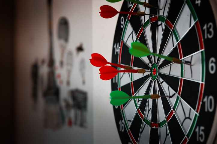 close up photo of dart pins on dartboard