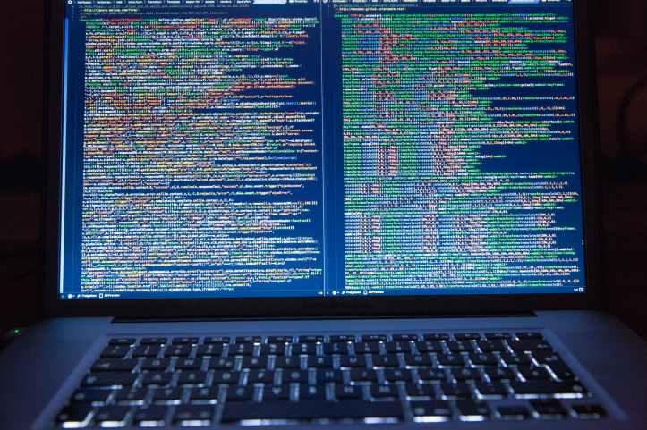 blue screen of death in silver black laptop