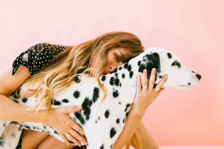 woman hugging adult dalmatian