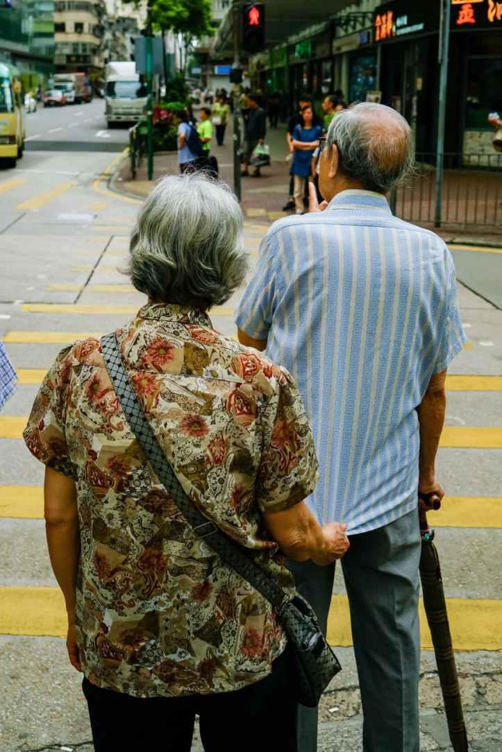man and woman standing beside pedestrian lane