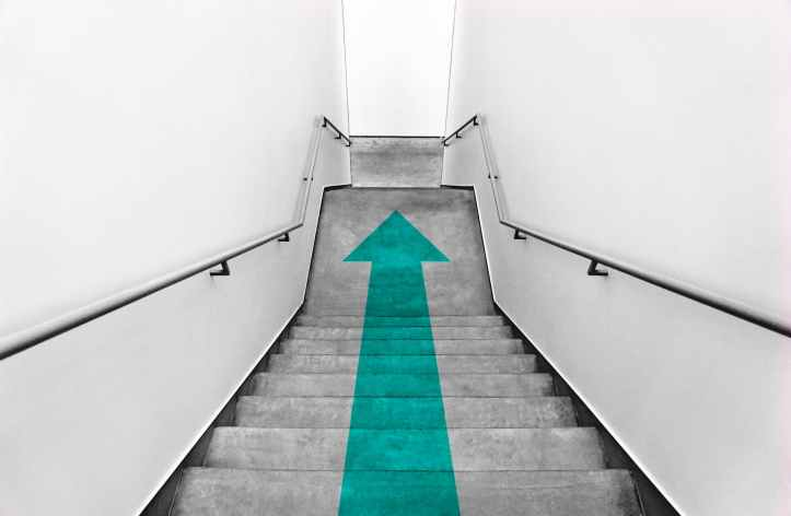 green arrow on stairs