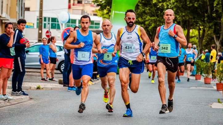 four men running on