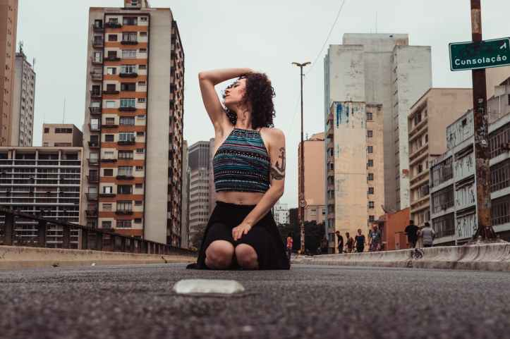 low angle photo of woman posing on street