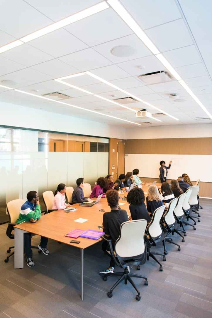 people having meeting inside conference room