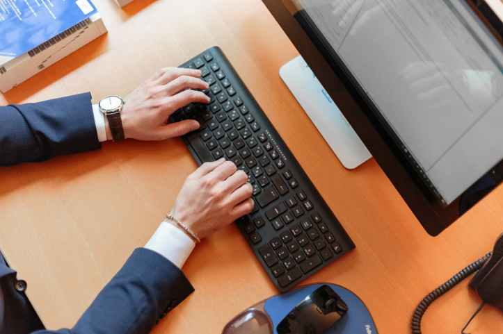 person typing on computer keyboard
