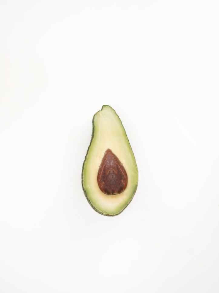 photo of half cut avocado