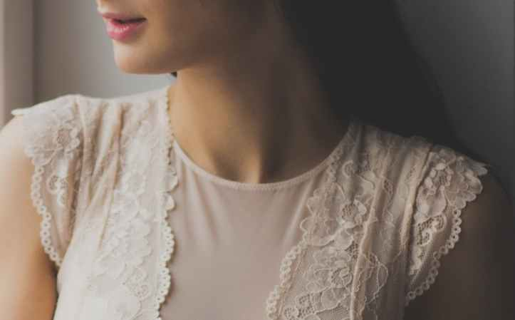 woman in white lace crew neck cap sleeves top