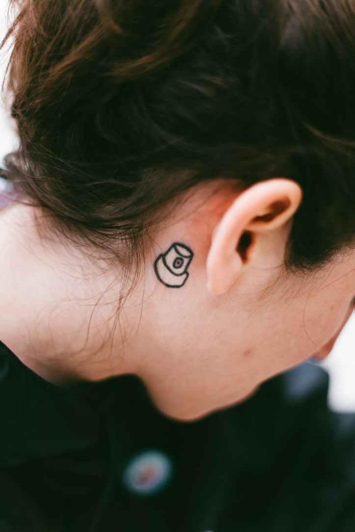 photo of tattoo near person s ear