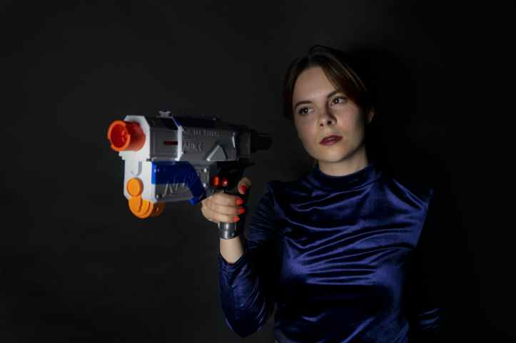 woman holding blue and white nerf gun