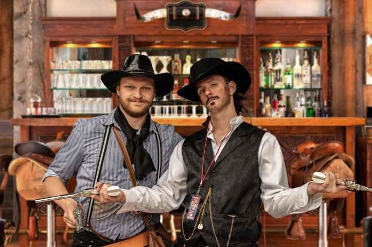 deux hommes debout a cote d une armoire en bois marron